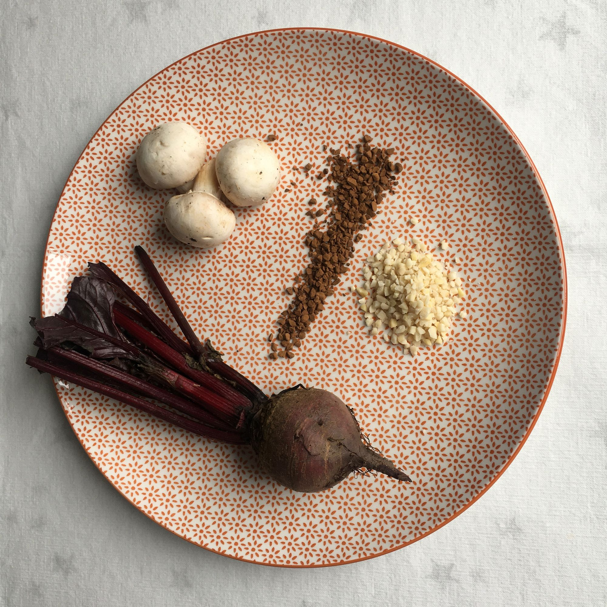 Plate with Tertiary Aroma objects - mushrooms, coffee, almonds, beet